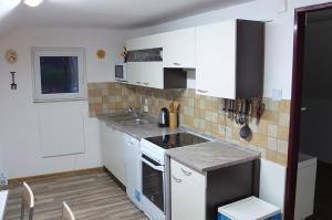 Kuchyň nebo kuchyňský kout v ubytování Apartman75