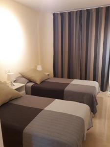 A bed or beds in a room at Apartamento Perla