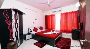 A bed or beds in a room at 2 BHK Service apartment in Borivali/kandivali east