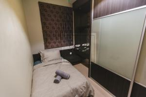 A bed or beds in a room at Marc Residence @ KLCC with Pool View Balcony