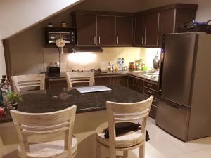 A kitchen or kitchenette at Villa Anyelir