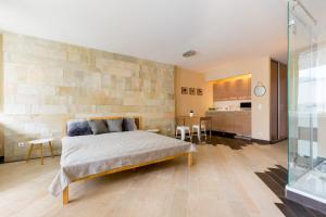 A bed or beds in a room at BPM-Riverhood Studio