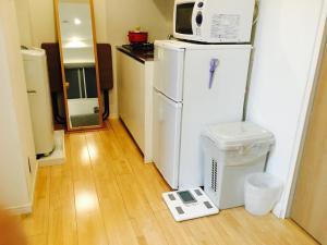 A kitchen or kitchenette at F05 Shin Okubo