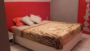 Un ou plusieurs lits dans un hébergement de l'établissement Maison de charme