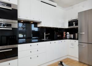 A kitchen or kitchenette at Rotermanni Luxury Apartment