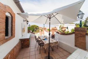 Um restaurante ou outro lugar para comer em AG Casa Colombo
