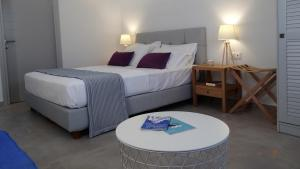 A bed or beds in a room at My Chorio Mykonos Country Summer House