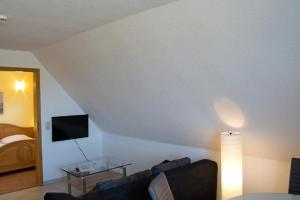 A television and/or entertainment center at Boddenhus Apartment 9