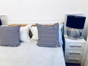 A bed or beds in a room at WHome | Gaia Deluxe Apartment