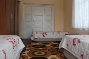 Krevet ili kreveti u jedinici u objektu Sümbüllü Konak Pansiyon