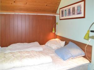 A bed or beds in a room at Holiday home Lyngshuse Herning II