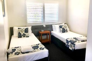A bed or beds in a room at Waterview Resort
