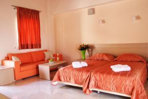 Ένα ή περισσότερα κρεβάτια σε δωμάτιο στο Eleana Boutique Hotel