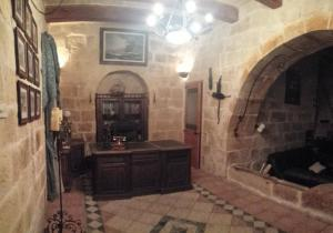A seating area at Malta. Zabbar 600 Year Old House of Character