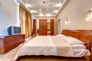 Vuode tai vuoteita majoituspaikassa Apartments on Sofievskaya Square