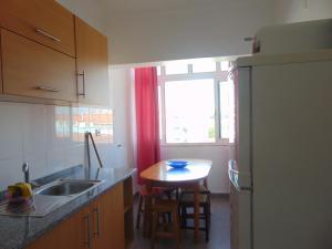 A kitchen or kitchenette at BEM ME QUER 1