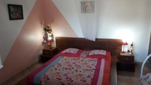 A bed or beds in a room at Le Bo Kay