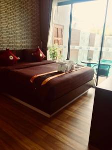 Un pat sau paturi într-o cameră la KG Private Pool Villa