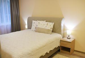 Lova arba lovos apgyvendinimo įstaigoje Apartments Victoria