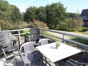 Ein Balkon oder eine Terrasse in der Unterkunft Hollumerstrand