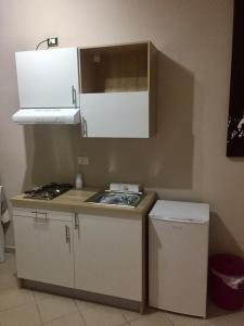 A kitchen or kitchenette at Corleone Bed