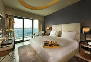 A bed or beds in a room at DAMAC Towers by DAMAC Living