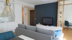 A seating area at Blue apartment