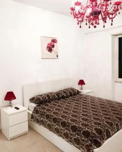 Ліжко або ліжка в номері Asher's House Colosseum