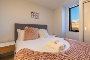 A bed or beds in a room at Star Victoria Serviced Apartments