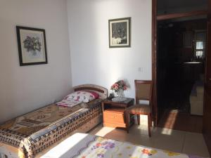 A bed or beds in a room at Apartment Iva Novakovica