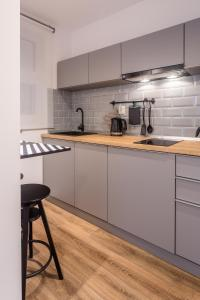 A kitchen or kitchenette at Nordic City Center 2 Rooms Luxury Apartment