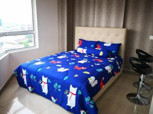 Ein Bett oder Betten in einem Zimmer der Unterkunft Octagon 21 Guest House