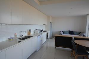 A kitchen or kitchenette at Large one bedroom in Burwood centre