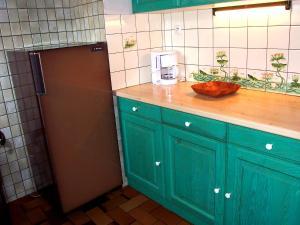 Cuisine ou kitchenette dans l'établissement Holiday Home Le Planot