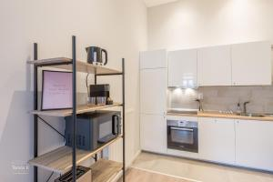 A kitchen or kitchenette at Liv Residence