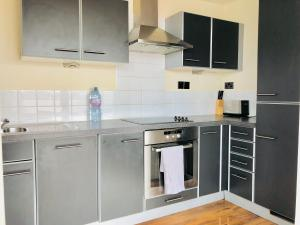 A kitchen or kitchenette at The Penthouse