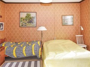 Säng eller sängar i ett rum på Holiday home Entsebo Järnforsen