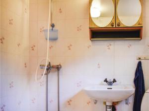 Ett badrum på Holiday home Entsebo Järnforsen
