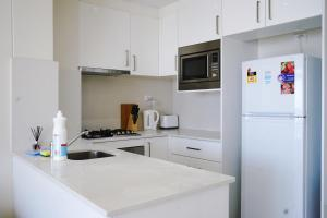 A kitchen or kitchenette at Burwood heart one bedroom stunning view &nice furnitures