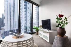 A television and/or entertainment center at Morden apartment near crown in CBD
