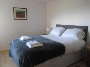 A bed or beds in a room at River Walk Inverness