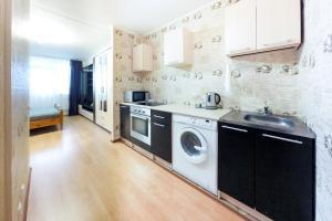 Кухня или мини-кухня в Апартаменты Авиатор