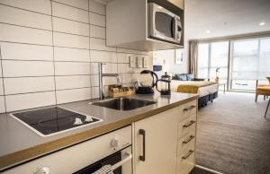 A kitchen or kitchenette at U Residence Hotel