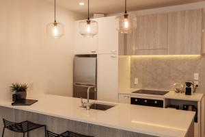 A kitchen or kitchenette at Character City Loft