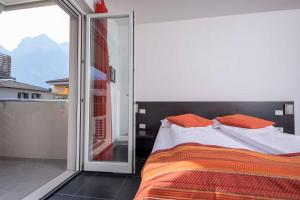 A bed or beds in a room at 4 Limoni Apartment Resort
