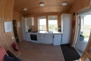 A kitchen or kitchenette at Myllulækur