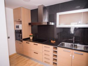 A kitchen or kitchenette at Sealand Sitges Apartments