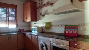 Una cocina o zona de cocina en Casas Rurales La Donal
