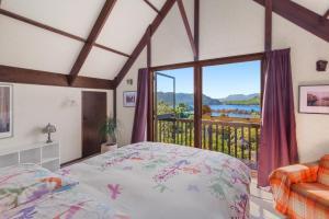 A bed or beds in a room at Lake Okareka Retreat