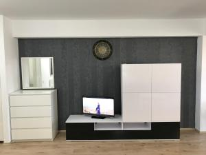 A television and/or entertainment center at Luxury Park Radox Apartment Airport Bucharest